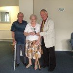 Peter Biggs presents silver cup to residents of Edith Court