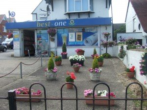 Best-One stores: front of store decorated with free-standing pots