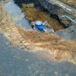 Blue control valve under surface of road